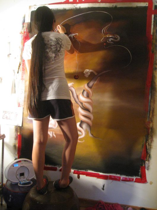 Victoria Yin, painting in her studio, age 12